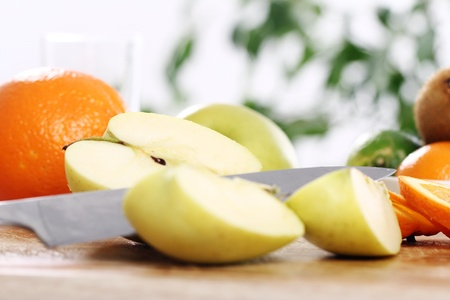 Different fresh fruits on the kitchen table Stock Photo - 12629400