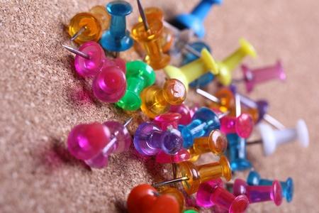 Colorful pins in cork board photo