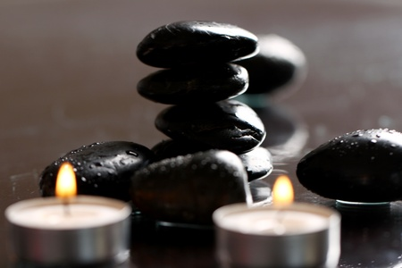 Close up of massage stones and candles photo