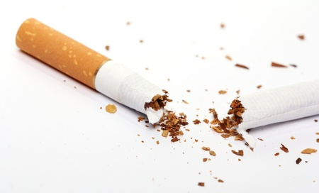 Close up of cigarette over white background