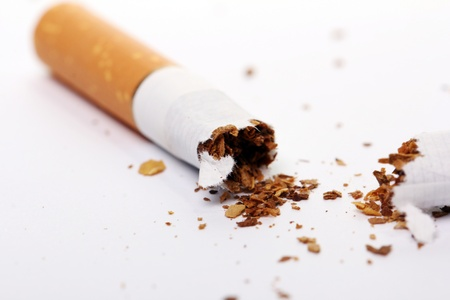 Close up of cigarette over white background photo