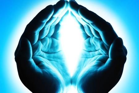 Human hands in blue light photo