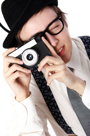 Old fashioned photographer over white background photo