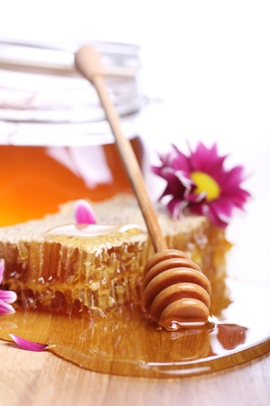 Fresh honey on the wooden table Stock Photo - 12992762