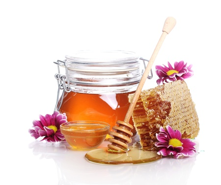 Jar with fresh honey over white background