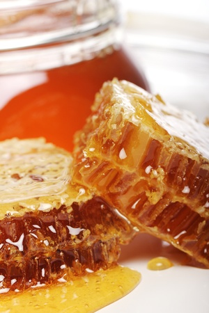 Close up of jar with fresh honey photo