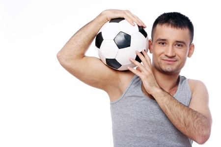 Attractive guy with soccer ball over white background photo