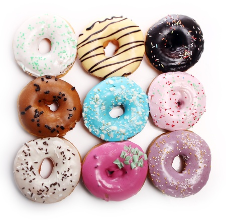 Colorful and tasty donutsover white background photo