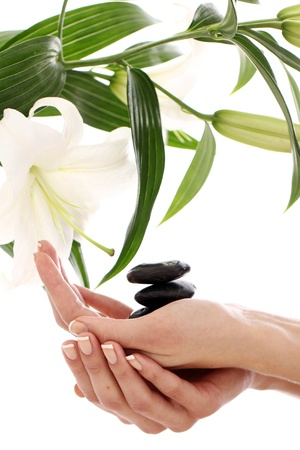 Beautiful spa hands over white background photo