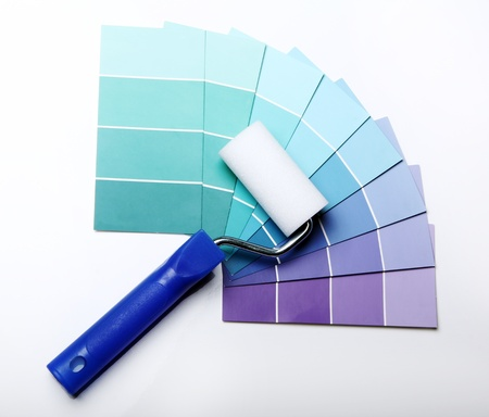 refurbishing: Close up of pantone color palette and roller Stock Photo