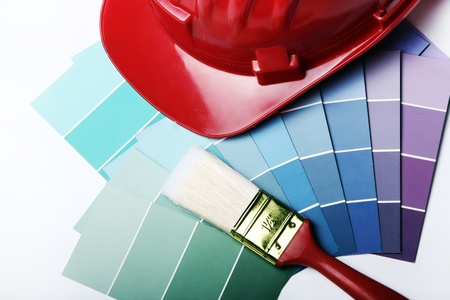 Color pallete with brushes and hard hat photo