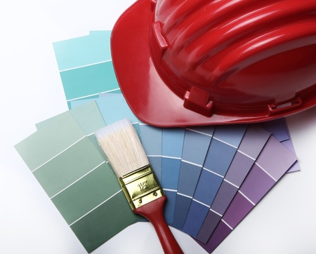 refurbishing: Color pallete with brushes and hard hat Stock Photo