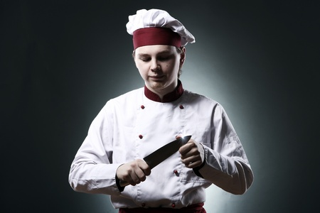 Serious chef with knife photo
