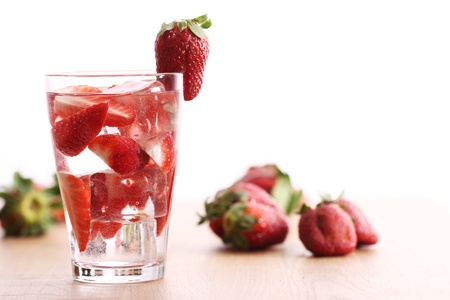 Glass of cold drink with strawberries Stock Photo - 13137435