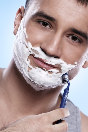 shaving blade: Portrait of handsome guy with shaving foam and razor Stock Photo