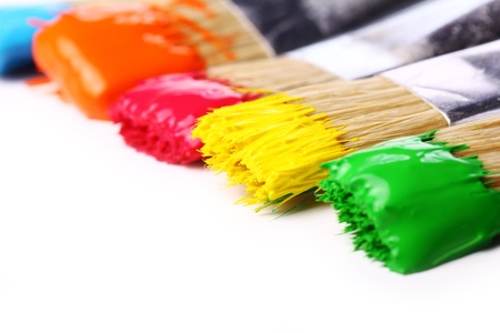 Close up of colorful paint and brushes Imagens