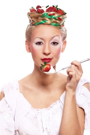 Woman with strawberry in her hairstyle over white background photo