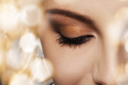 Close up of woman face with eye makeup photo