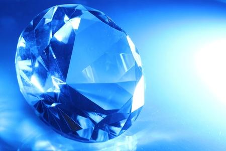 Big and beautiful jewel in blue light photo