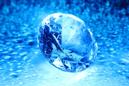 Big and beautiful jewel with water drops in blue light