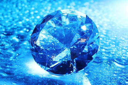 Big and beautiful jewel with water drops in blue light  photo