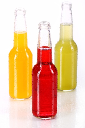 single beer bottle: Bottles with colorful cocktail over white background Stock Photo