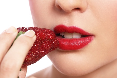 Close up of woman lips and strawberry photo