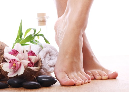 feet naked: Beautiful woman legs and different spa items  Stock Photo