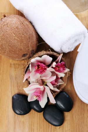 Different spa items over wooden surface photo