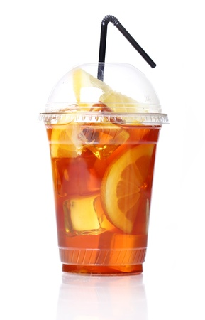 Fresh ice tea in plastic glass on white background photo
