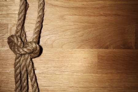 Old rope over wooden background photo