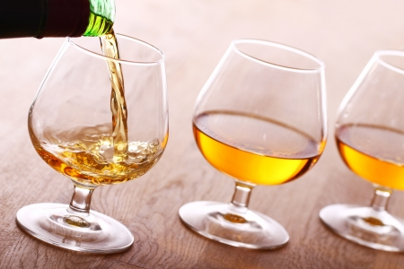 Pouring a cognac into the glass photo