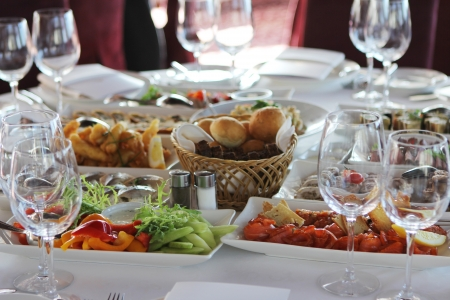 Banquet table in restaurant with different snacks photo