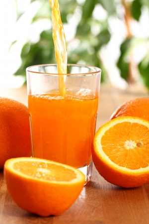 Fresh orange juice on the table photo