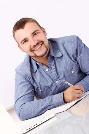 Young and handsome businessman at his workplace Stock Photo - 13889188