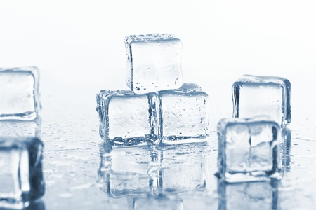 Cold ice cubes with water drops photo