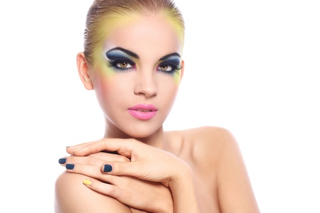 Beautiful woman with colorful make-up over white background photo