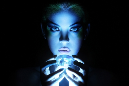 Beautiful woman with big jewel in darkness photo
