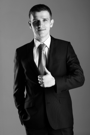 ifestyle: Black and white portrait of handsome businessman showing OK Stock Photo