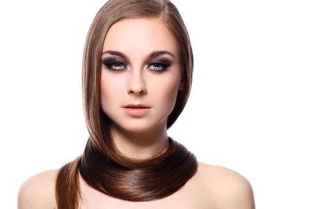 Young woman with beautiful hair over white bakcground photo