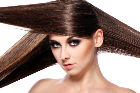 Young woman with beautiful hair over white bakcground Stock Photo - 14176196