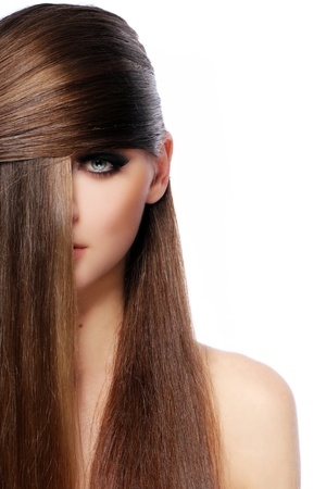 sensuality: Young woman with beautiful hair over white bakcground