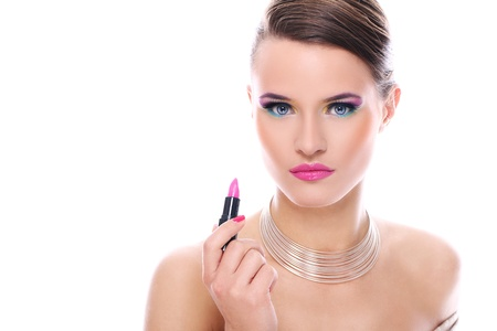Beautiful woman with pink lipstick over white background photo