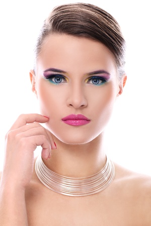 Young woman with beautiful make-up over white background photo