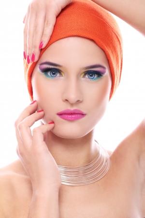 Beautiful woman in orange shawl over white background photo