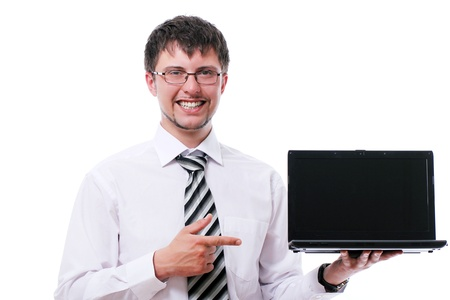 Smiling businessman pointing on the  laptop display over white background photo