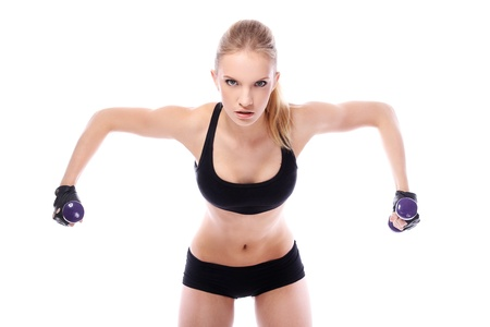 Beautiful woman doing exercises with dumbells over white background photo