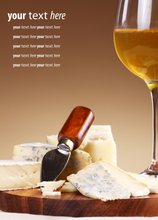 cork board: Wine and fresh cheese on the table