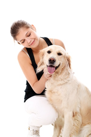 Happy woman and her beautiful dog over white background photo
