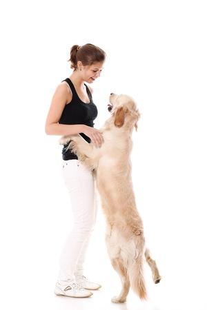 mujer con perro: Feliz mujer y su hermoso perro sobre fondo blanco Foto de archivo
